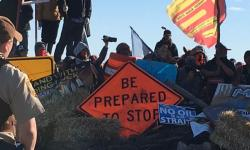 Protesters block Highway 1806 as they set up a north camp