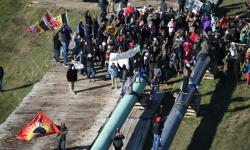 Protesters gather on pipe